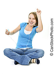 Teenage girl listening to music with her mp3 player