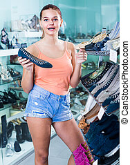 teenage girl looking after shoes