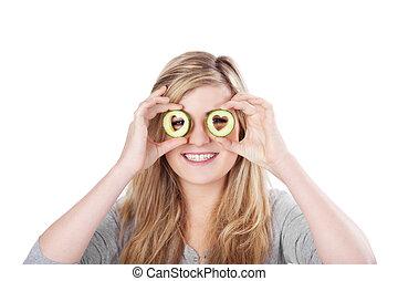 Teenage girl looking through cucumbers