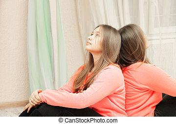 Teenage girl looking up closeup