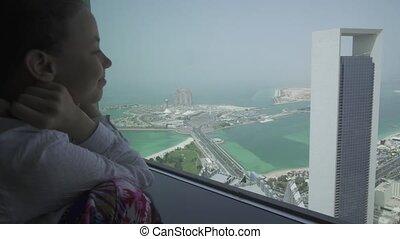 Teenage girl looks through the Abu Dhabi telescope from...