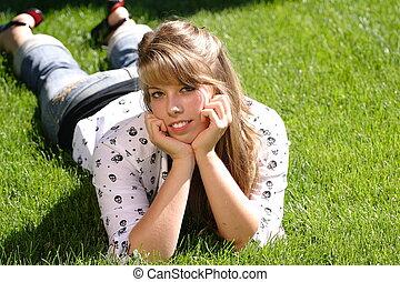 Teenage Girl Lying in the Grass