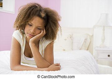 Teenage Girl Lying On Bed