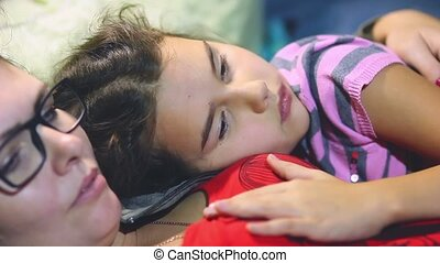 Teenage girl lying on the chest mother and daughter