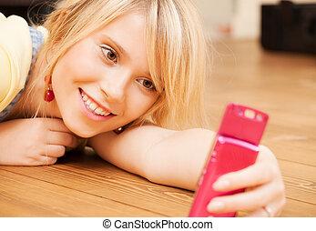 teenage girl making self portrait with smartphone -...