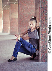 teenage girl near marble columns