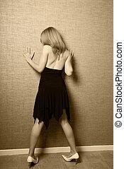 Teenage girl near the wall - A teenage girl is pressing...