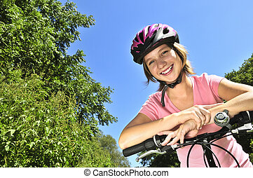 Teenage girl on a bicycle - Portrait of a teenage girl on a ...