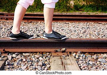 Teenage Girl on Rail - Teenage girl walking on rail