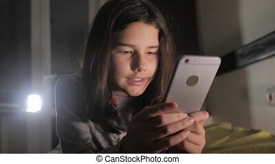Teenage girl online shopping lifestyle looks on her...