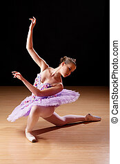 Teenage girl performing ballet in studio