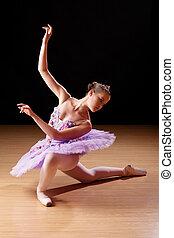 Teenage girl performing ballet in studio