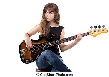 Teenage girl playing on guitar