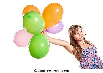 Teenage girl playing with balloons