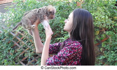 Teenage girl playing with puppy