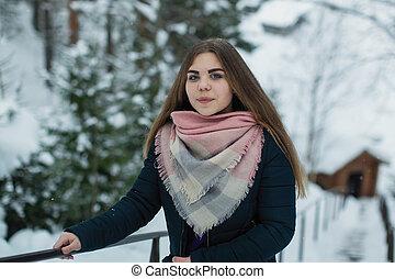 Teenage girl portrait outdoors in winter.