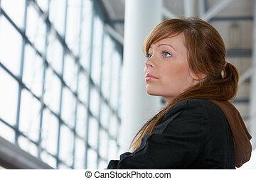 Teenage Girl Portrait - Teenage girl in modern building,...