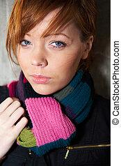 Teenage girl portrait, wearing scarf, looking at camera