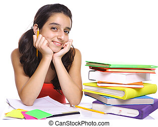 Teenage girl posing for the camera near her books