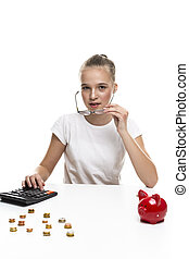 Teenage Girl In Glasses Posing With Coins and Moneybox For Savings. Vertical Image Composition