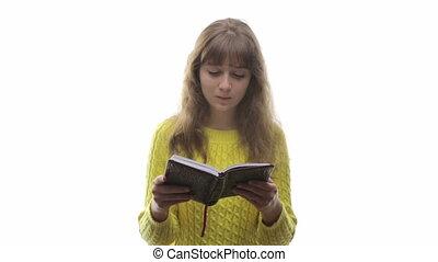 Teenage girl reading a book with di