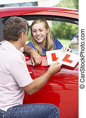 Teenage Girl Receiving Her Learner Plates