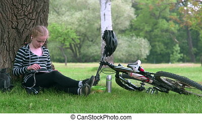 Teenage girl resting after riding bicycle