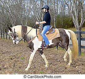 Teenage Girl Riding a Horse