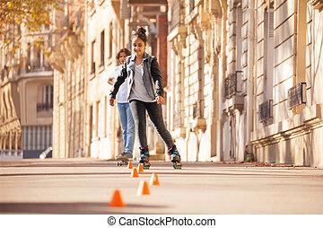 Teenage girl roller skating at city side walk