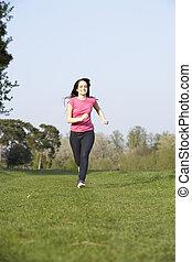 Teenage Girl Running Through Summer Meadow