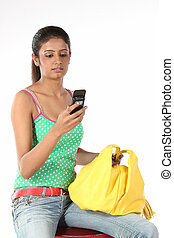 Teenage girl sending sms