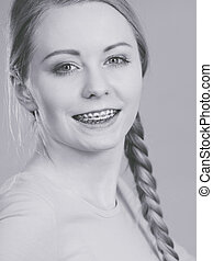 Teenage girl showing her teeth with braces