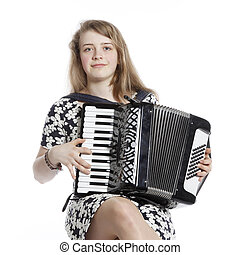 teenage girl sits in studio with accordion against white...