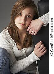 Teenage Girl Sitting In Studio
