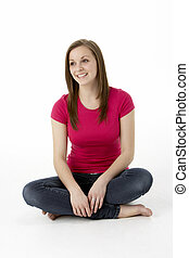 Teenage Girl Sitting In Studio