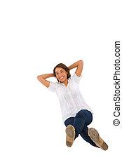 teenage girl sitting with hands behind head