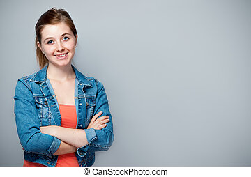 Teenage girl - smiling teenage girl standing with crossed ...