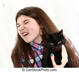 teenage girl sniffing and sneeze from cat fur particles due to allergy