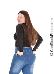 Teenage girl standing from the back in jeans