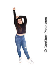 Teenage girl standing from the front raising one arm
