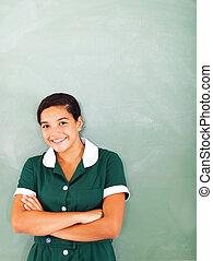teenage girl standing in front of chalkboard - teenage girl ...