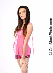teenage girl standing in pink dress