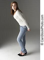 Teenage Girl Standing In Studio