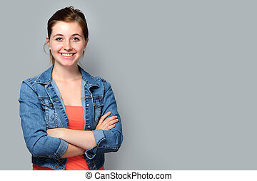Teenage girl standing with crossed arms - Smiling teenage ...