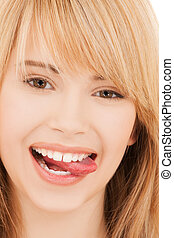 teenage girl sticking out her tongue - health and beauty...