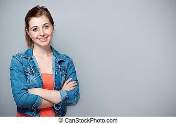 Teenage girl - smiling teenage girl standing with crossed...