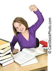 Teenage girl studying - Happy teenage girl studying at the...