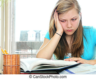 Teenage girl studying with textbooks looking unhappy