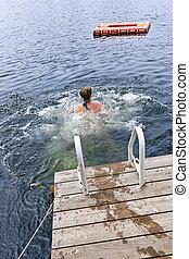 Teenage girl swimming in lake