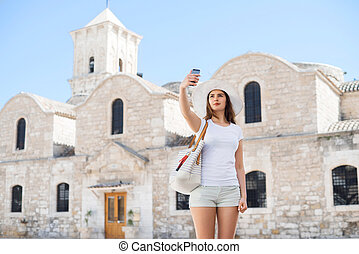 Teenage girl taking a selfie on a vacation